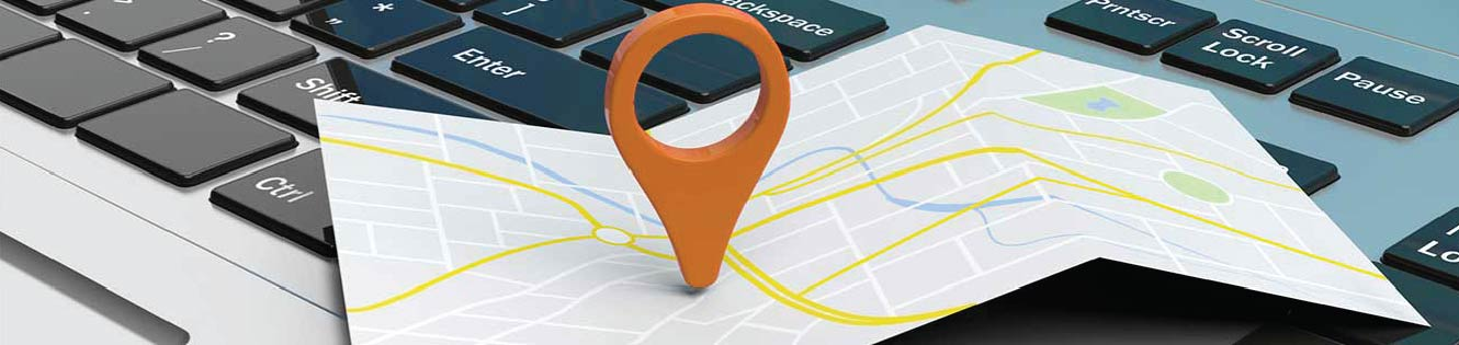 Location pin on a map that is on a laptop.